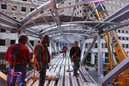 Steel Workers Installing a Skybridge
