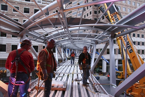 Steel Workers Installing a Skybridge
