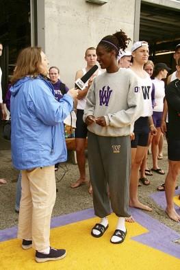 Radio Reporter Interviewing UW Crew Member