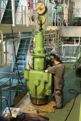 Crew Inspecting a Cylinder Cap