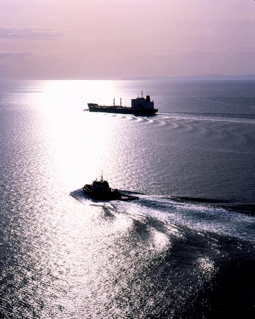 Tugboat Escorting Oil Tanker