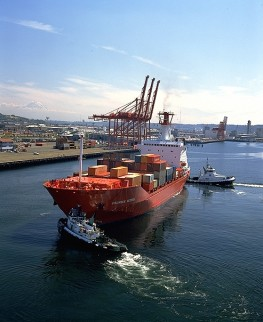 Tugboats Docking Container Ship